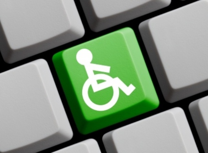 Green accessibility sign on keyboard