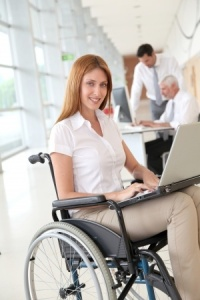 Female office worker using wheelchair